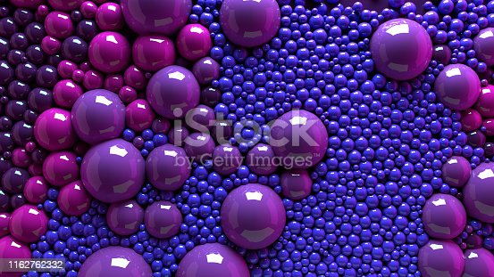 istock 4k 3d animation of spheres and balls colorful rainbow in a organic motion background. Top view of bubbles colorful paint 1162762332