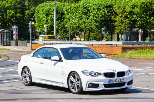 BMW (F33) 4-series Dresden, Germany - July 20, 2014: White sports car BMW (F33) 4-series in the city street. touring car stock pictures, royalty-free photos & images