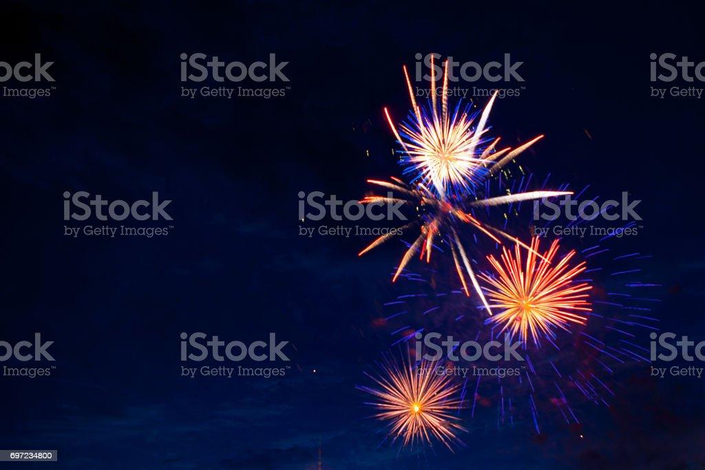 4th July fireworks display on dark sky. stock photo