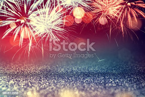 istock 4th July fireworks with glitter sparkle Abstract background 980813556