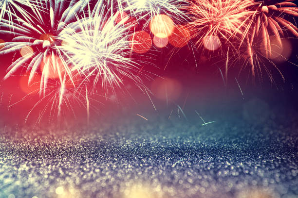 4th july fireworks with glitter sparkle abstract background - july stock photos and pictures