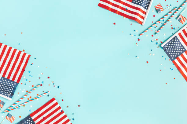 4th of July American Independence Day decorations on blue background. Flat lay, top view, copy space stock photo
