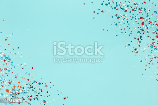 973461098 istock photo 4th of July American Independence Day decorations on blue background. Flat lay, top view, copy space 1157312875