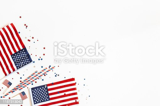 istock 4th of July American Independence Day decorations on white background. Flat lay, top view, copy space 1157313042