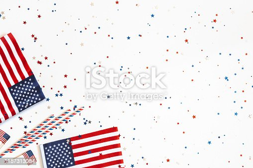 istock 4th of July American Independence Day decorations on white background. Flat lay, top view, copy space 1157313084