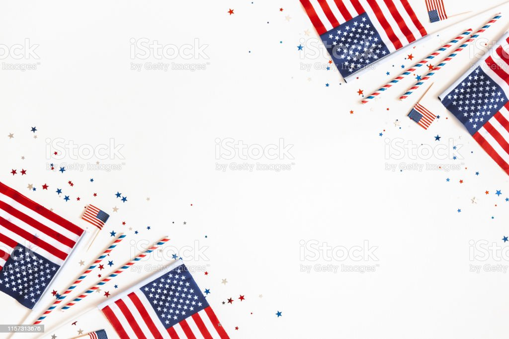4th of July American Independence Day decorations on white background. Flat lay, top view, copy space 4th of July American Independence Day decorations on white background. Flat lay, top view, copy space Above Stock Photo