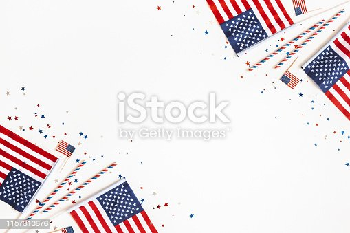 973461098 istock photo 4th of July American Independence Day decorations on white background. Flat lay, top view, copy space 1157313676