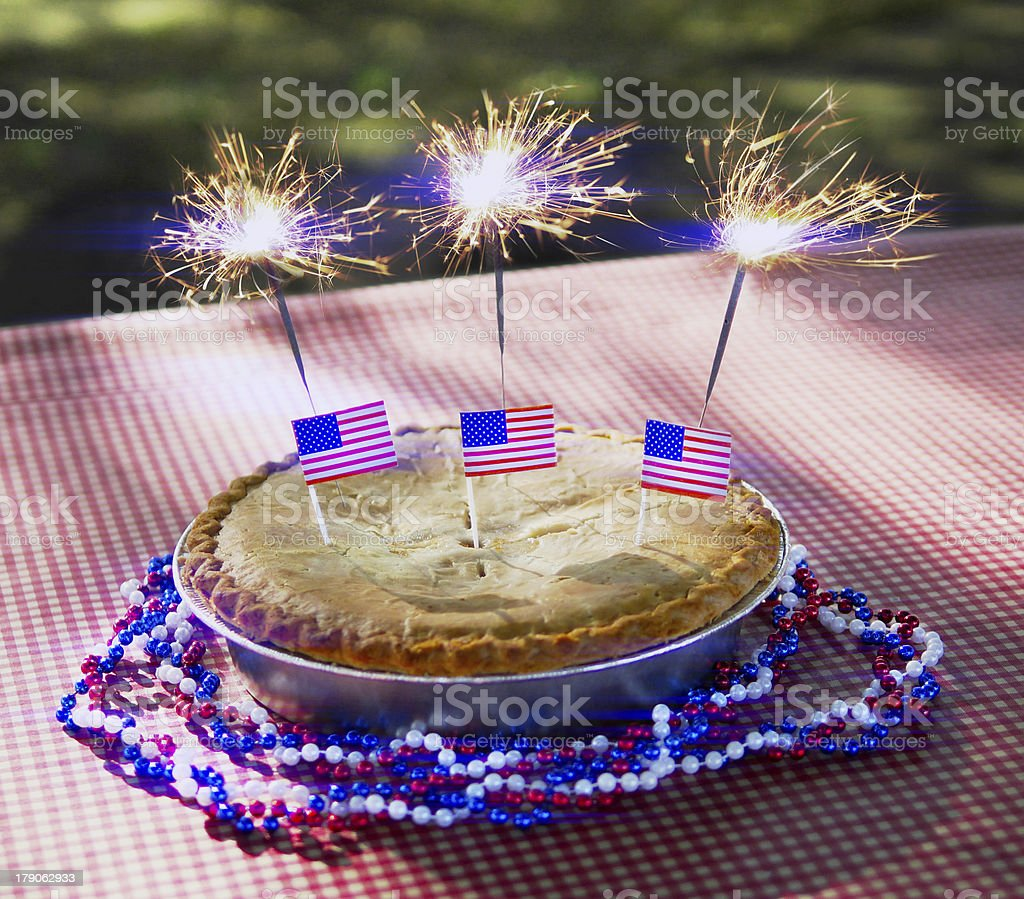 4th of July Apple Pie with Sparklers Close-Up stock photo