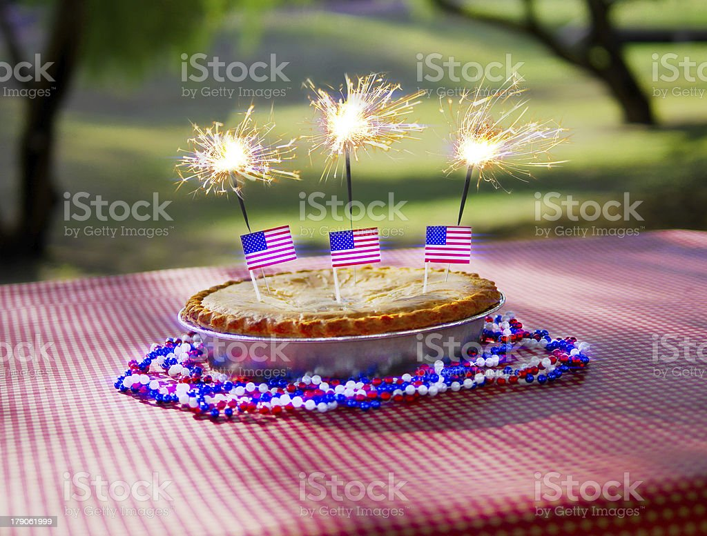 4th of July Apple Pie with Sparklers stock photo