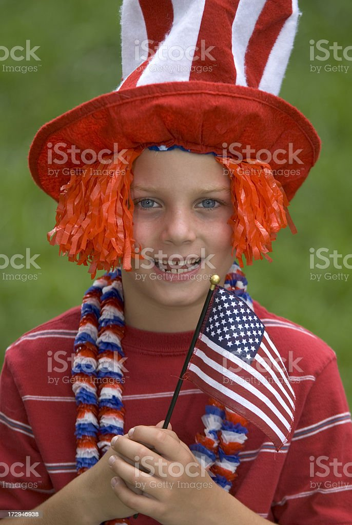 4th of July Boy With Flag and Uncle Sam Hat stock photo