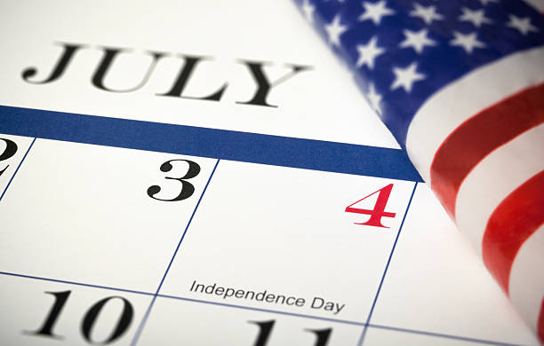 4th of July calendar with American flag stock photo