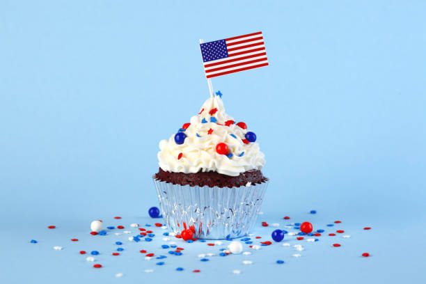 4th of July cupcake with flag and sprinkles stock photo
