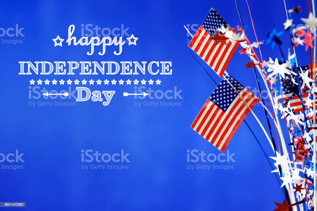 4th of July decorations on blue background stock photo
