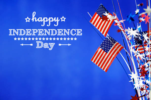 4th of july decorations on blue background - independence day стоковые фото и изображения