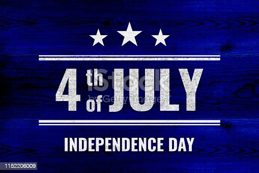 971061452 istock photo 4th of july independence day - white painted drawn over blue wooden planks 1152206009