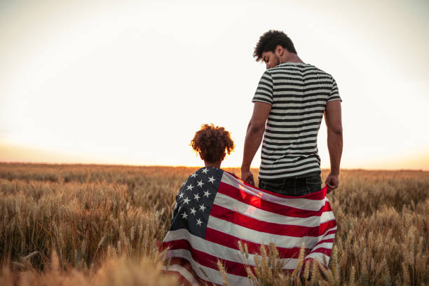 4th of July Father and daughter holding American flag family 4th of july stock pictures, royalty-free photos & images