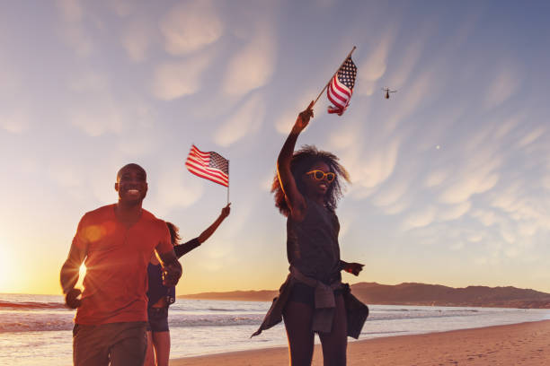 4th of July Friends celebrating 4th of July at the beach, California independence day photos stock pictures, royalty-free photos & images