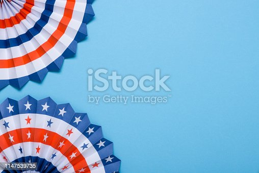 istock 4th of July USA flag theme paper fans on blue background 1147539735