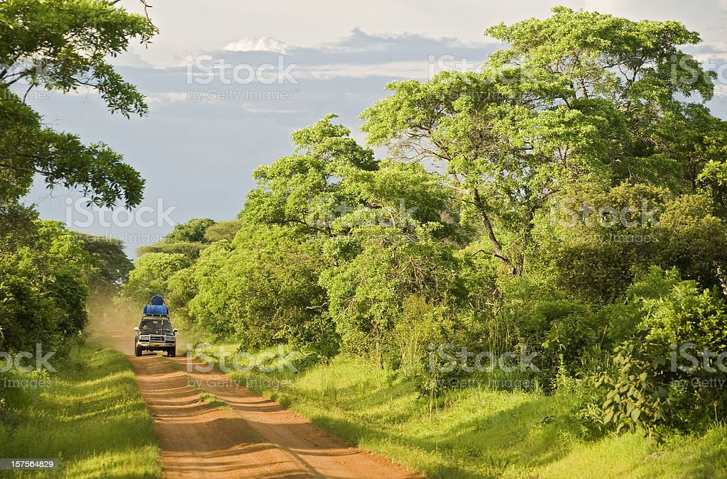 4wd car on an unpaved road in rural Africa stock photo