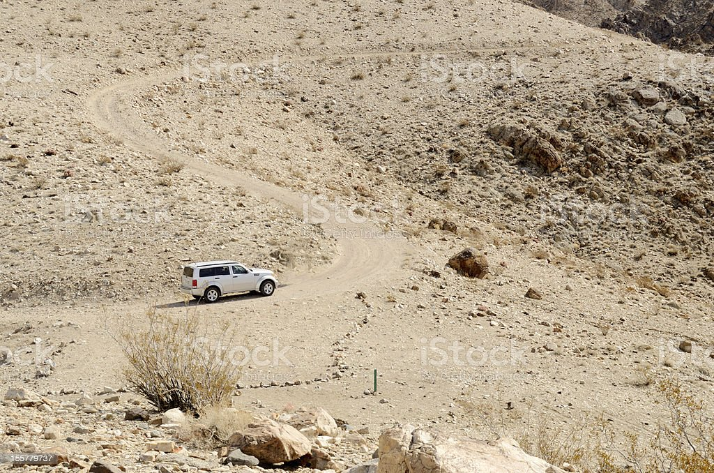 4wd jeep driving in desert stock photo