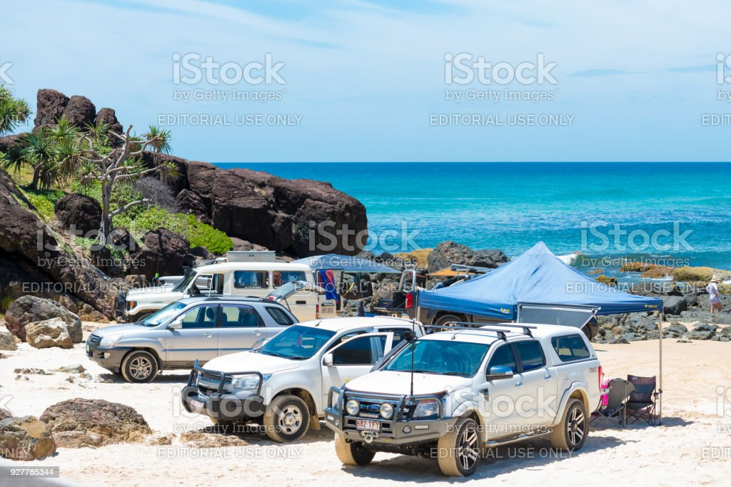 4wd vehicles at Rainbow Beach with coloured sand dunes, QLD, Australia stock photo