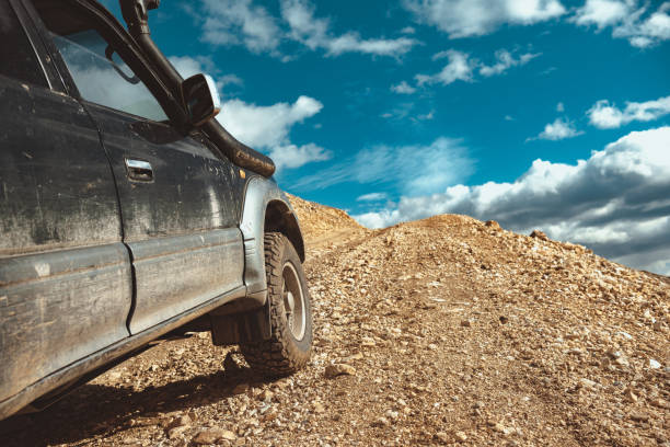 4x4 car driving uphill is mountains