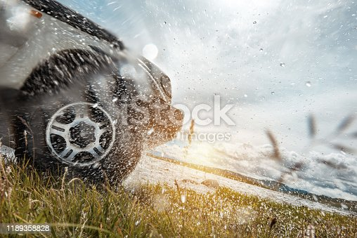 4x4 concept with car wheel and water splashes