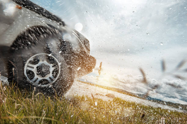 4x4 car wheel and water splashes