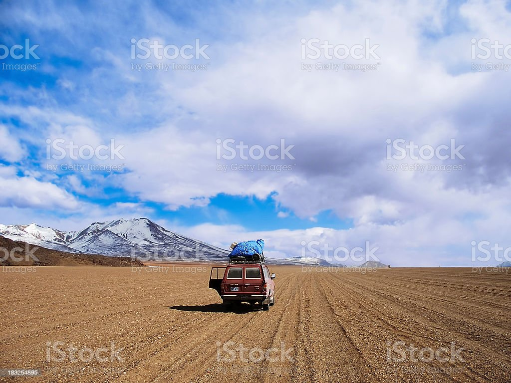 A 4x4 jeep travelling on a dirt road royalty-free stock photo