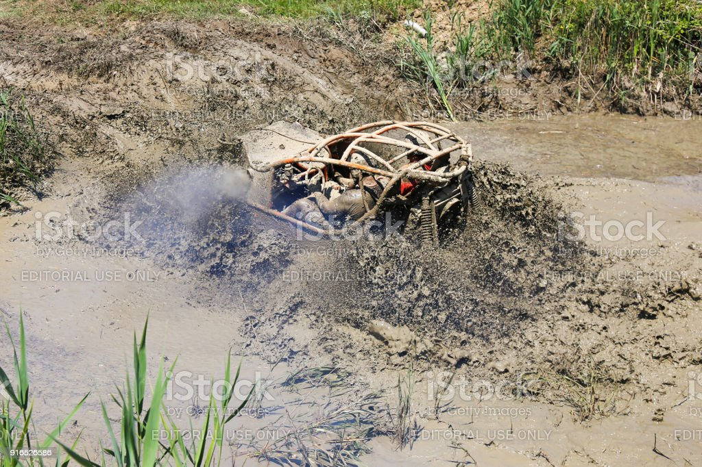 4x4 offroad car - 4wd car splashing mud and water with big tires stock photo