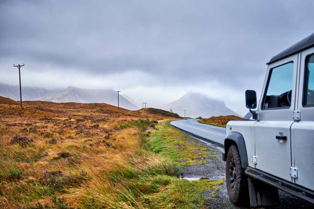 A 4x4 parked along a path during a road trip in Scotland. stock photo