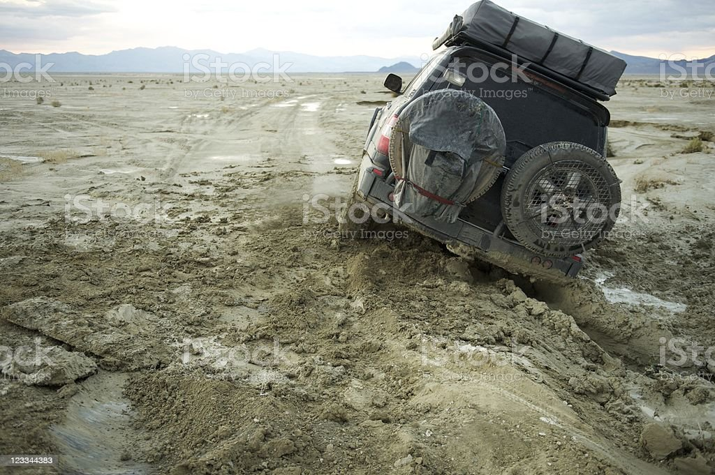 4x4 stuck in the mud at sunset, Nevada, US stock photo