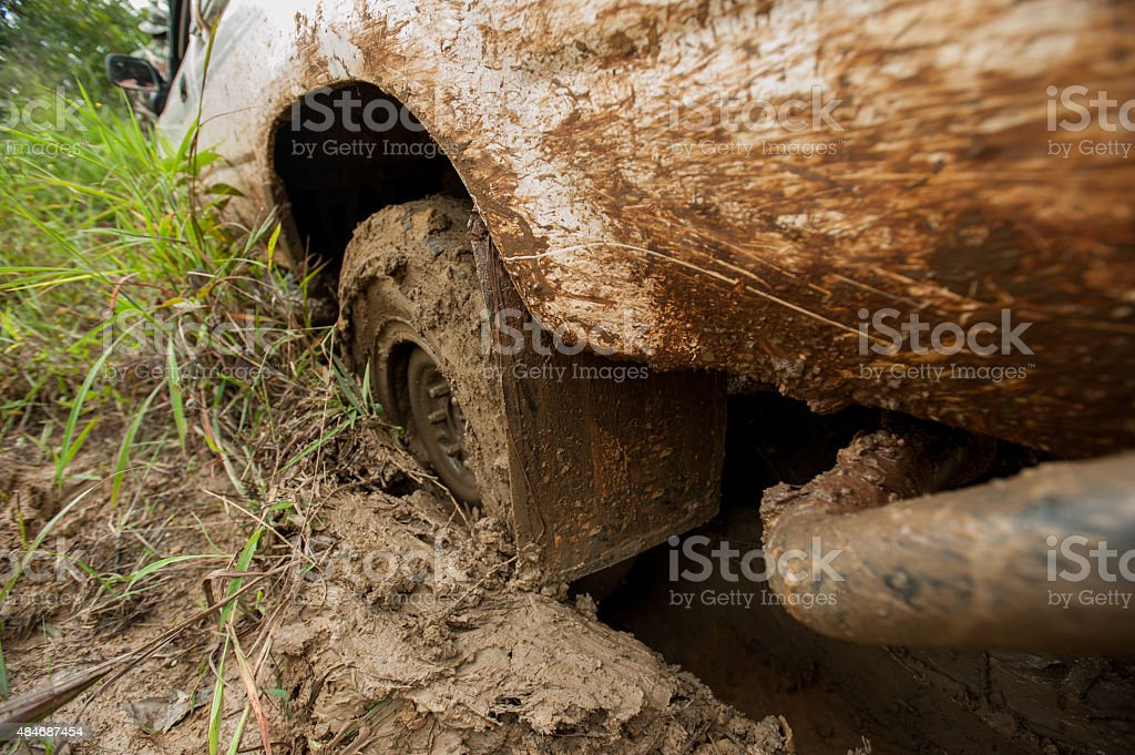 4x4 WD Car's wheels in mud in the forest, off-road stock photo