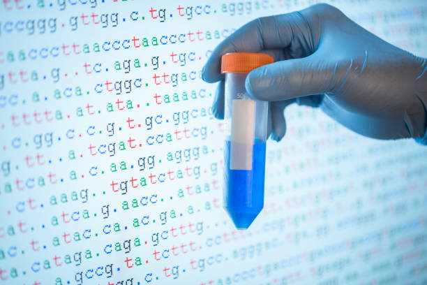 50ml centrifuge tube with blue solution with DNA sequence in the background stock photo