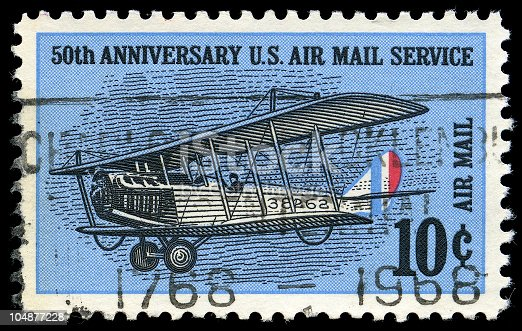 50th Anniversary (1918 - 1968) US Air Mail Service - 10 Cent Stamp. Texture can be seen on ink on surface of the stamp. Selective focus.