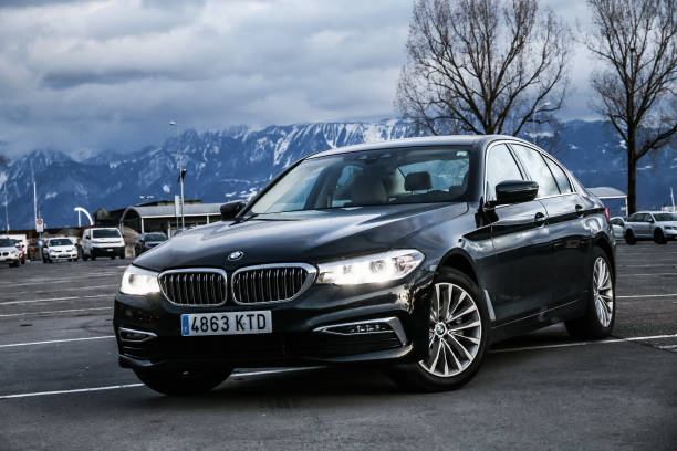 BMW 520d Lausanne, Switzerland - March 11, 2019: Black motor car BMW 520d (G30) in the city street. bmw stock pictures, royalty-free photos & images