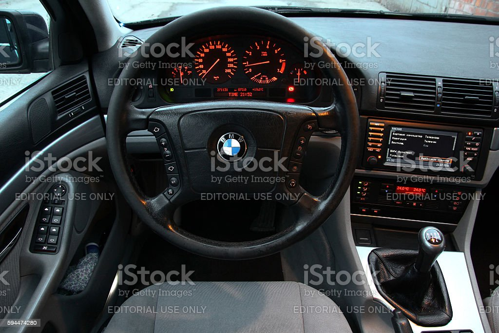 BMW E39 520i Novyy Urengoy, Russia - July 23, 2015: Interior of the classic german sedan BMW E39 520i in the darkness. BMW Stock Photo