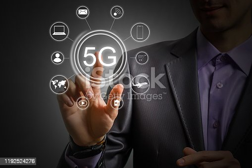 917493152istockphoto 5g internet concept with businessman pressing buttons 1192524276