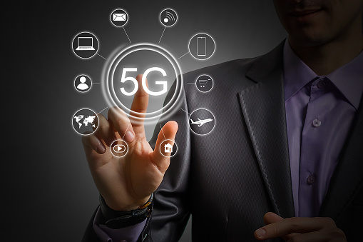 917493152 istock photo 5g internet concept with businessman pressing buttons 1192524276