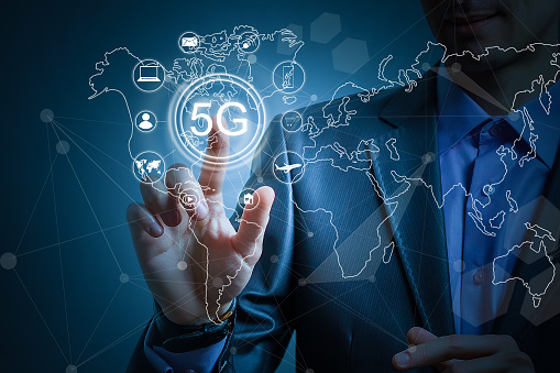 917493152 istock photo 5g internet concept with businessman pressing buttons 1192524293