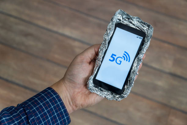 5g smartphone with aluminum foil case stock photo