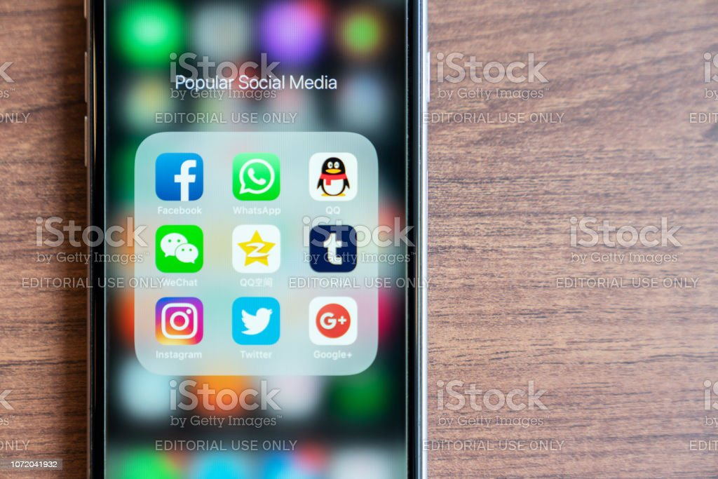 BANGKOK,THAILAND - OCTOBER 5th, 2018 : iPhone with icon of popular social media app are trendy in 2018. Facebook, Whatsapp, QQ, WeChat, QZone, Tumblr, Instagram, Twitter, Google+ app are on screen