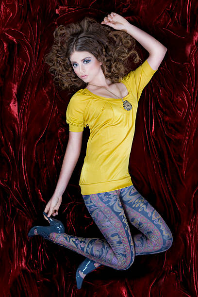 60s retro young woman fashion model in leggings on velvet - beautiful curvy girls stock photos and pictures