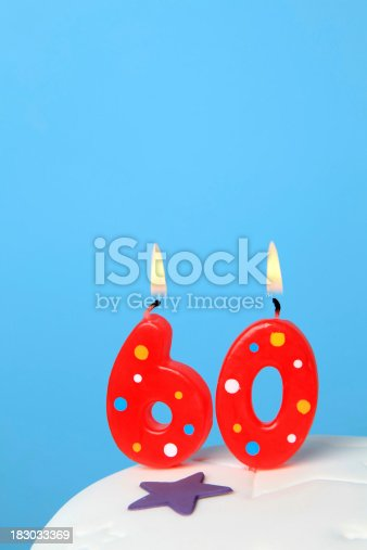 Red Birthday candles against blue background