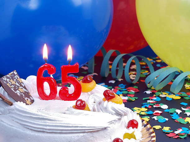 65th. Anniversary 65th. Anniversary / Birthday cake in a Party background with balloons and party strings. 65 69 years stock pictures, royalty-free photos & images