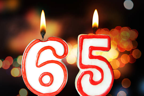 65th birthday Birthday candles celebrating 65th birthday 65 69 years stock pictures, royalty-free photos & images