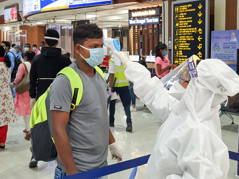 6th June 2020- Bagdogra Airport,Siliguri, West Bengal, India-Passengers in protective gear being themal scanned for covid screening by airport crew at Bagdogra airport.