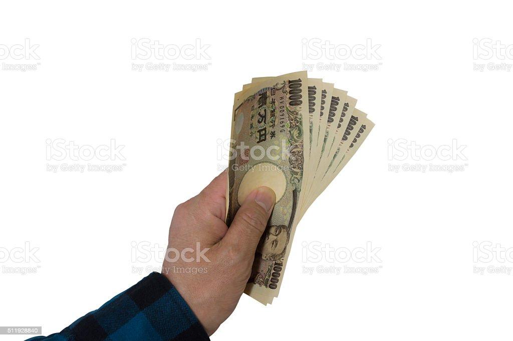 70.000yen bills in hand stock photo