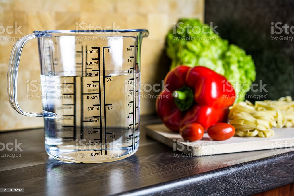 750ml Water In Measuring Cup On Kitchen Counter With Food stock photo