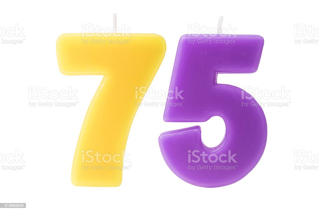 75th birthday candles isolated stock photo